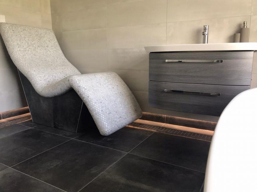 heated lounge chair in bathroom design